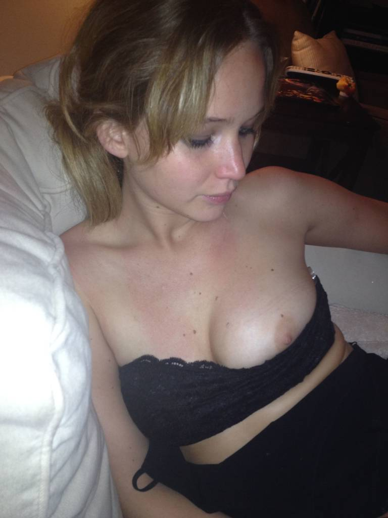 Jennifer Lawrence Nipple Popping Out Of Shirt While Sititng On Couch